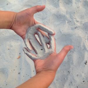 Illustrasjonsbilde: Hender i sanden